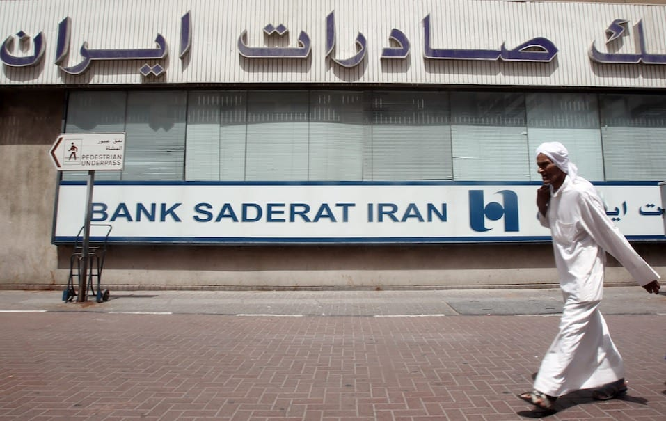 A guy walks past Bank Saderat Iran one of the Islamic republic' s top trading partners